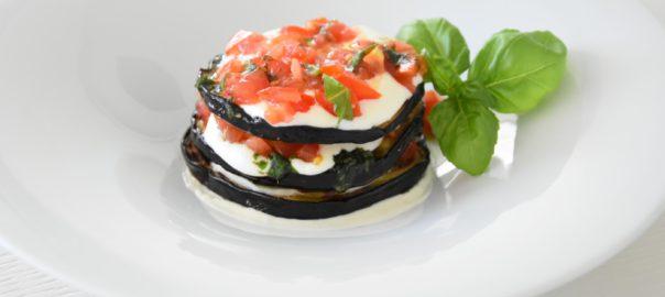 parmigiana estiva: melanzane grigliate, pomodorini, basilico, crema di burrata con scorza di limone