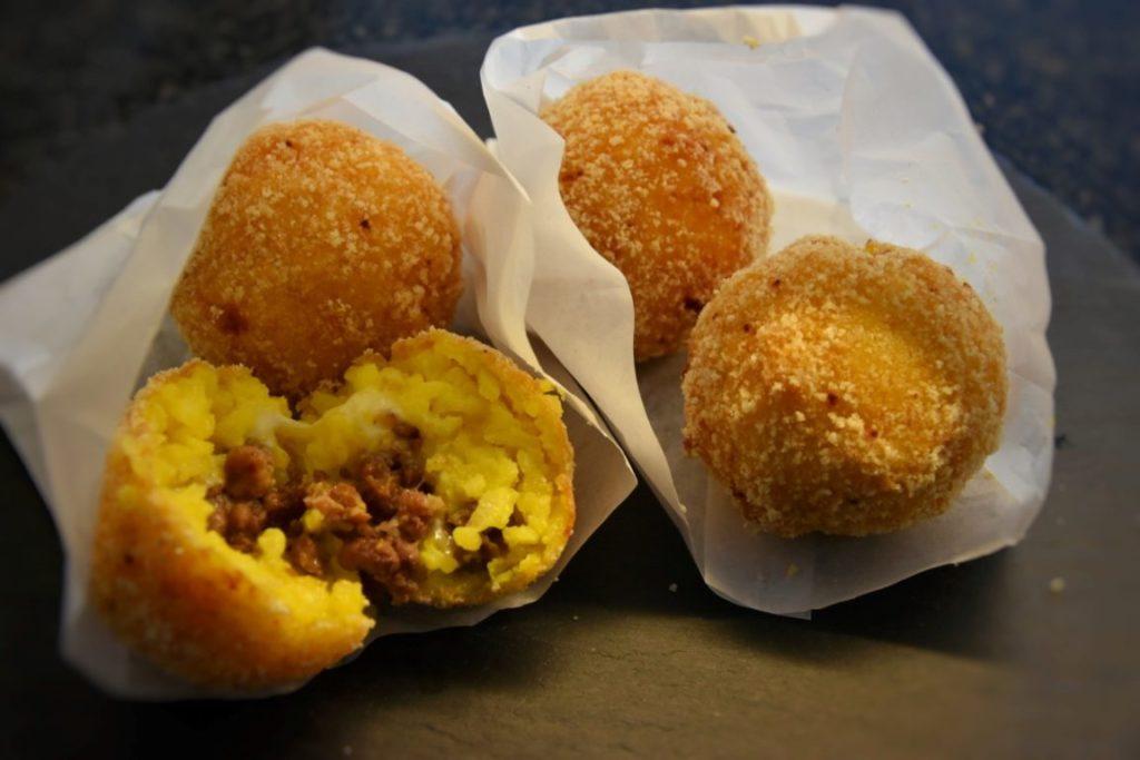 arancini ticinesi: arancini di luganiga formaggella e merlot